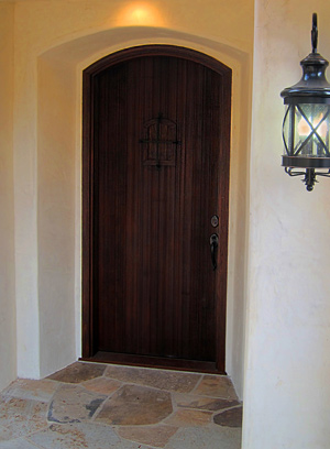 small spanish style entry door with stone work in Montecito California real estate