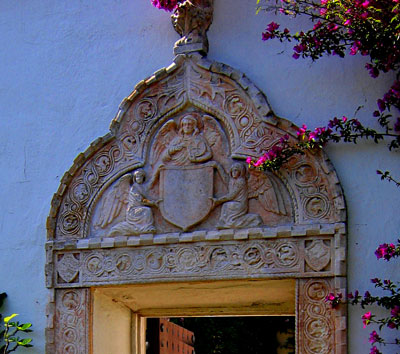 Angels depicted in a romantic Stone Frieze in a Santa Barbara Spanish style garden