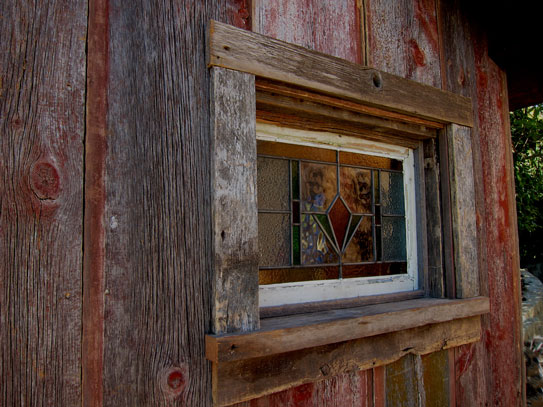 vintage-stained-glass-windows-in-old-shed-photos